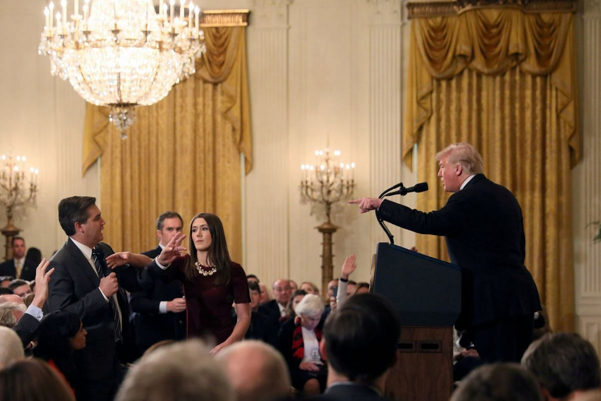 US President Donald Trump and CNN's Jim Acosta in a fiery exchange during a news conference following midterm US congressional elections, at the White House in Washington, US, on Nov 7, 2018.