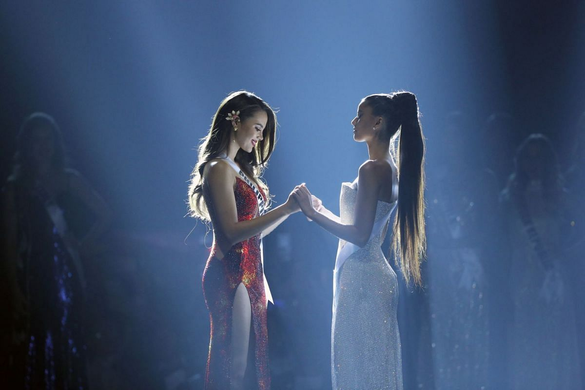 Miss Philippines Catriona Gray (left) and Miss South Africa Tamaryn Green hold hands as they wait for the winner to be announced during the final round of the Miss Universe pageant in Bangkok, Thailand, on Dec 17, 2018.