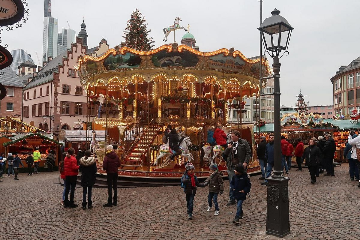 Frankfurt's Weihnachtsmarkt, which sports a cheery merry-go-round (above). Mediaeval town Rothenburg ob der Tauber has no fewer than seven Kathe Wohlfahrt stores (above) which specialise in Christmas decorations and toys. A lebkuchen, or gingerbread,