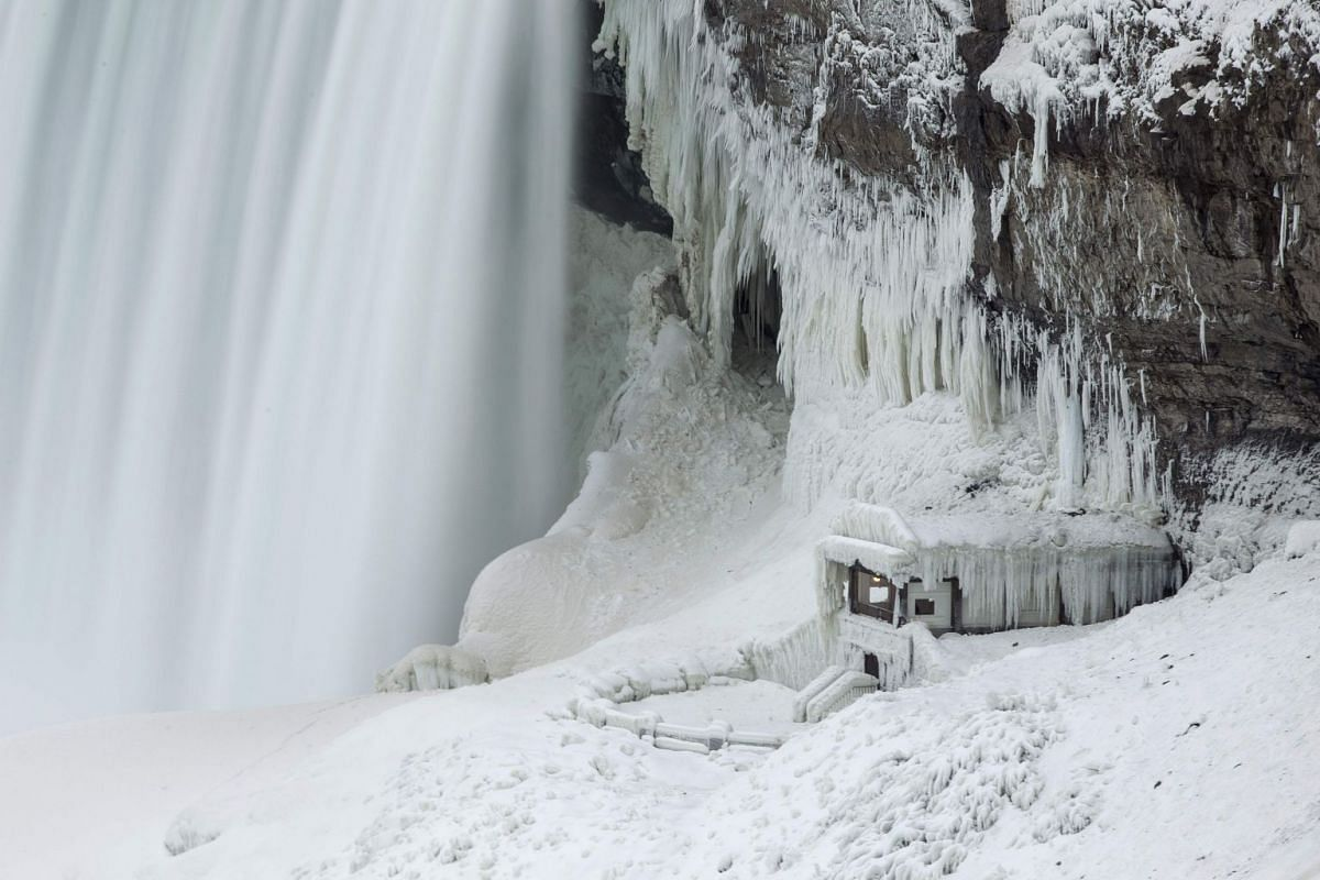 """An observation point at the base of Niagara Falls is covered with ice on Jan 9, 2018. A giant winter """"bomb cyclone"""" walloped the US East Coast on Jan 5, 2018, with heavy snow and freezing cold that made for treacherous travel conditions and bone-chil"""