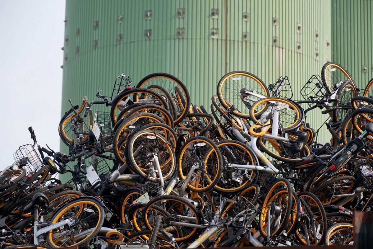 Discarded oBikes at a recycling firm on July 14, 2018. oBike abruptly ceased operations in June, citing difficulties in meeting the new requirements and guidelines by the Land Transport Authority to curb indiscriminate parking.
