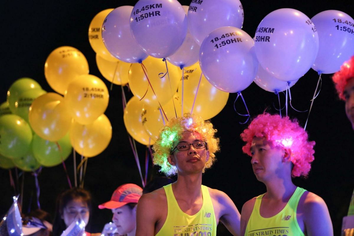 Pacers for the 18.45km leg of The Straits Times Run getting into the mood before the flag off on Sept 23, 2018. The sixth edition of the run drew more than 13,000 to the Sports Hub, where participants enjoyed live entertainment, food trucks and even