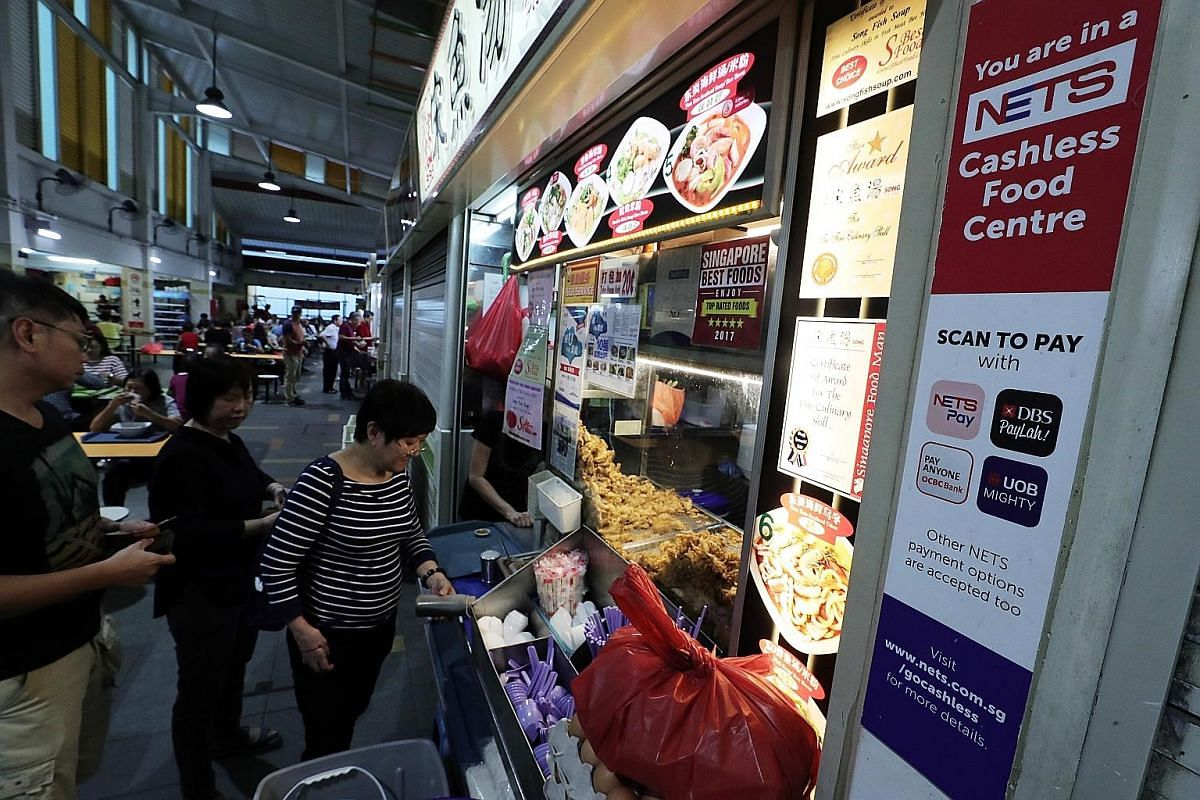 Under its cashless payment system, Nets will give hawkers hardware to accept e-payments from 20 sources, including e-wallets.