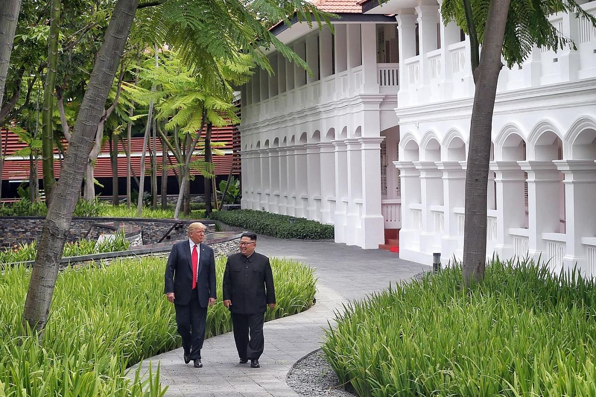 US President Donald Trump and North Korean leader Kim Jong Un strolling through the grounds of the Capella Hotel on Sentosa Island after their working lunch, during their historic summit in Singapore on June 12. The summit marked the first meeting between