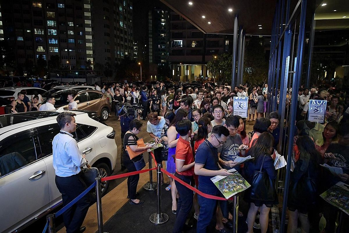 The queue outside the Riverfront Residences on July 5. More than 1,000 units were sold at three residential projects in just a few hours on the night before the implementation of tougher property cooling measures.