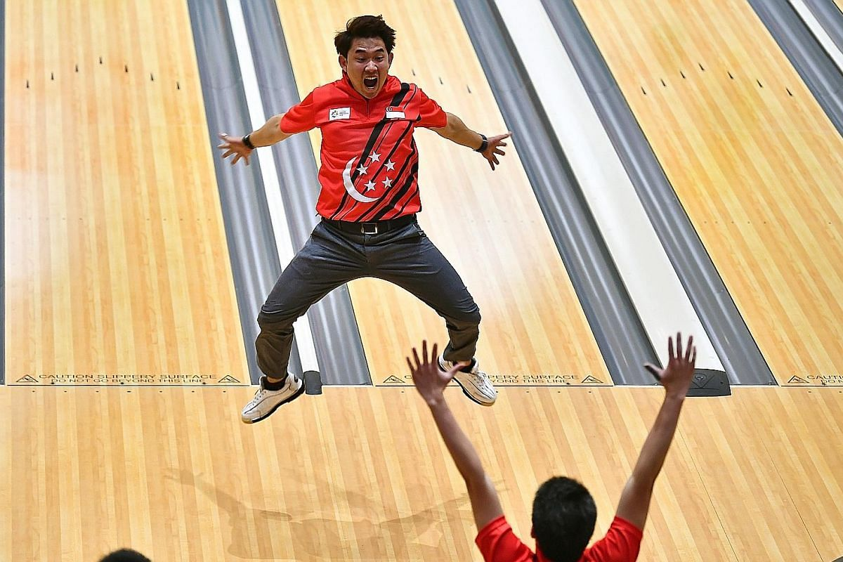 Muhammad Jaris Goh celebrating after his strike in the men's trios event at Jakabaring Bowling Centre in Palembang, Indonesia, on Aug 23 gave Singapore a bronze medal in the Asian Games.