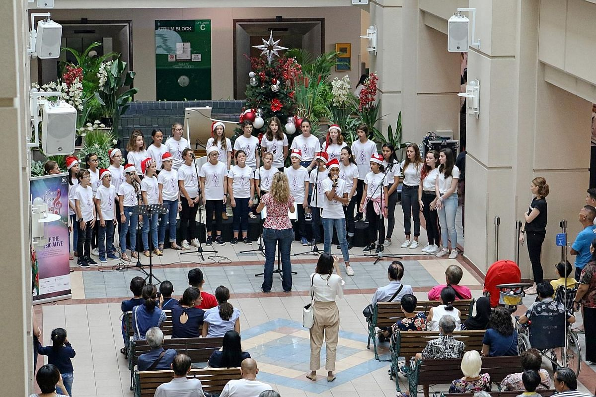 A concert organised by Sing'theatre at the lobby of Tan Tock Seng Hospital.