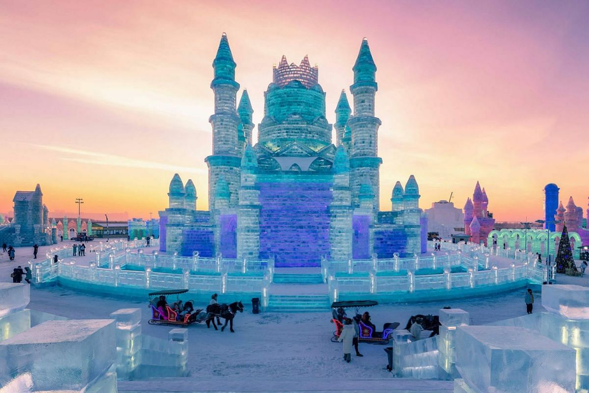 People visiting the Harbin Ice-Snow World in Harbin, China's northeastern Heilongjiang province on December 24, 2018. The Harbin Ice and Snow Sculpture Festival will kick off in the city on January 4, 2019, which attracts hundreds of thousands of vis