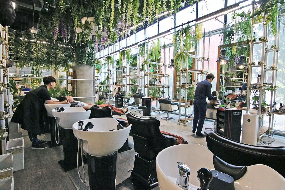Above: The garden-themed Walking on Sunshine hair salon in Orchard Central houses a cafe that serves brunch and Korean-inspired food. Left: Chez Vous: HideAway in Ngee Ann City boasts themed areas designed for photos, including a millennial pink room