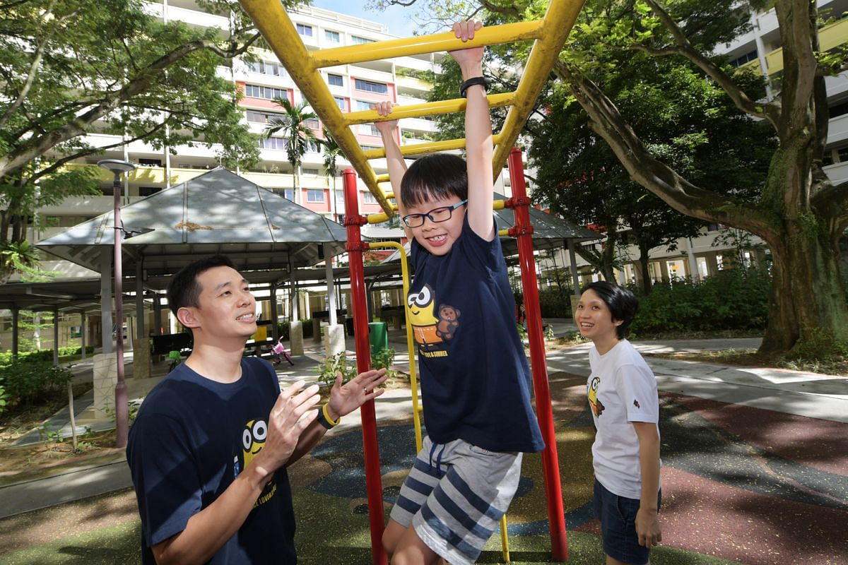 Caleb, eight, has mastered the monkey bars after being challenged by his parents Kevin Goh and Fannie Lim.
