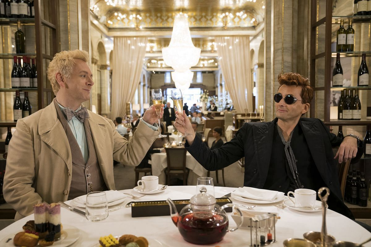 Michael Sheen (left) plays angel Aziraphale, who forms an enemies-with-benefits relationship with a demon, Crowley, played by David Tennant (right), in Good Omens.