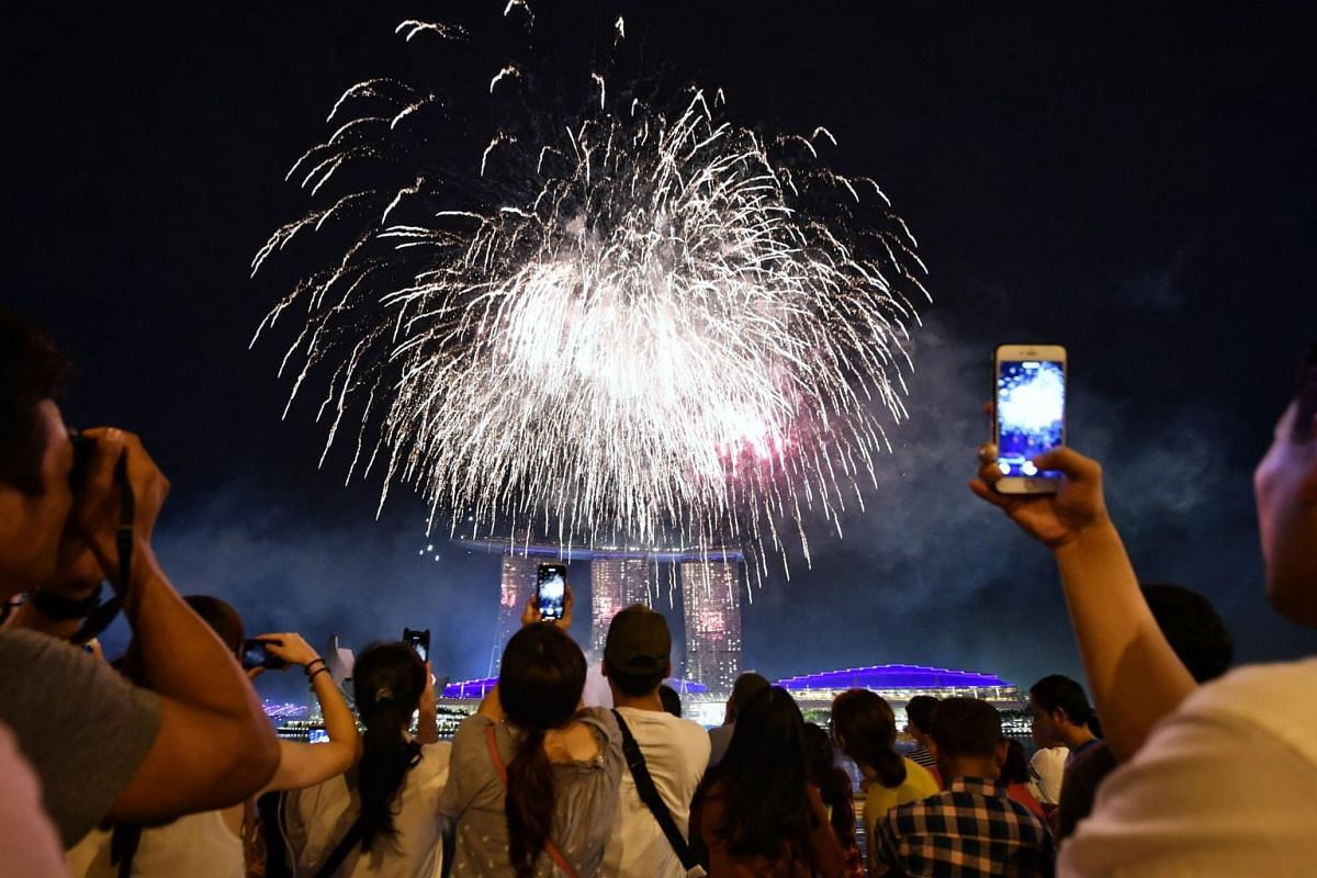 Members of the public watching the fireworks display at the Jubilee Bridge.
