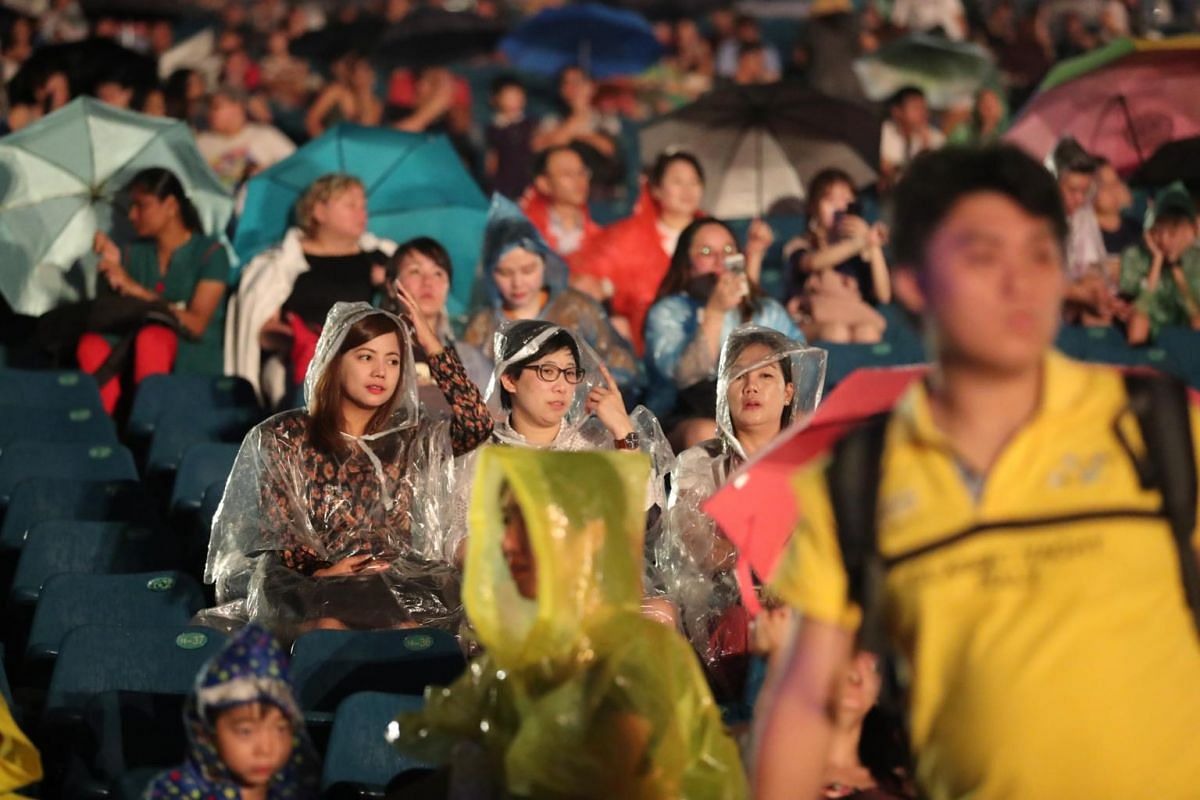 Members of the public braving the rain to catch the fireworks.