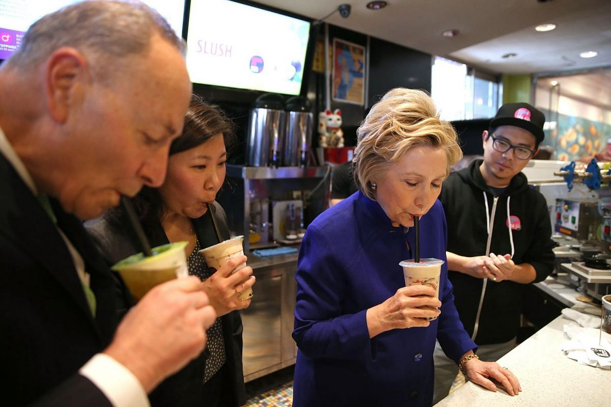 US presidential candidate Hillary Clinton drinking bubble tea at Kung Fu Tea at a mall outlet in the Queens borough of New York City while campaigning in 2016.