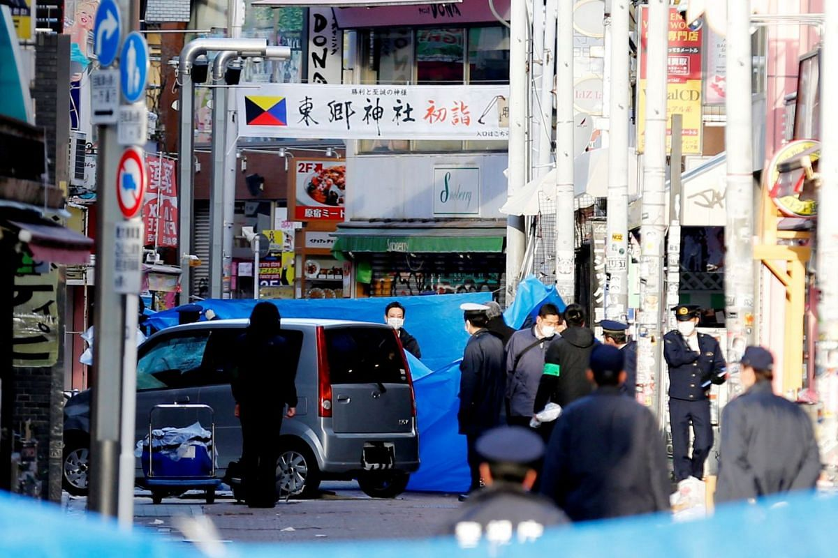 Policemen stand next to a car which plowed into pedestrians on New Year's day in Tokyo, Japan, January 1, 2019. PHOTO: REUTERS