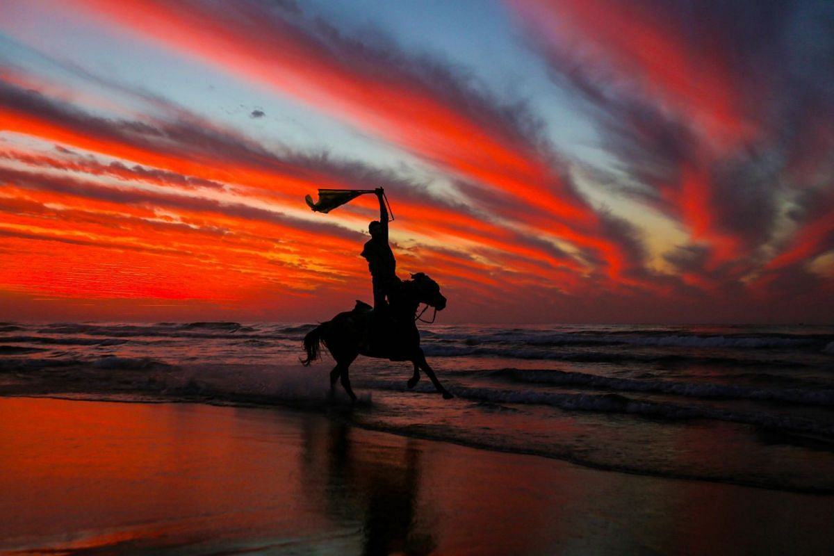 A Palestinian horseman rides on the beach at sunset a few hours prior to the new year's celebrations, west of in Gaza city on December 31, 2018. PHOTO: AFP