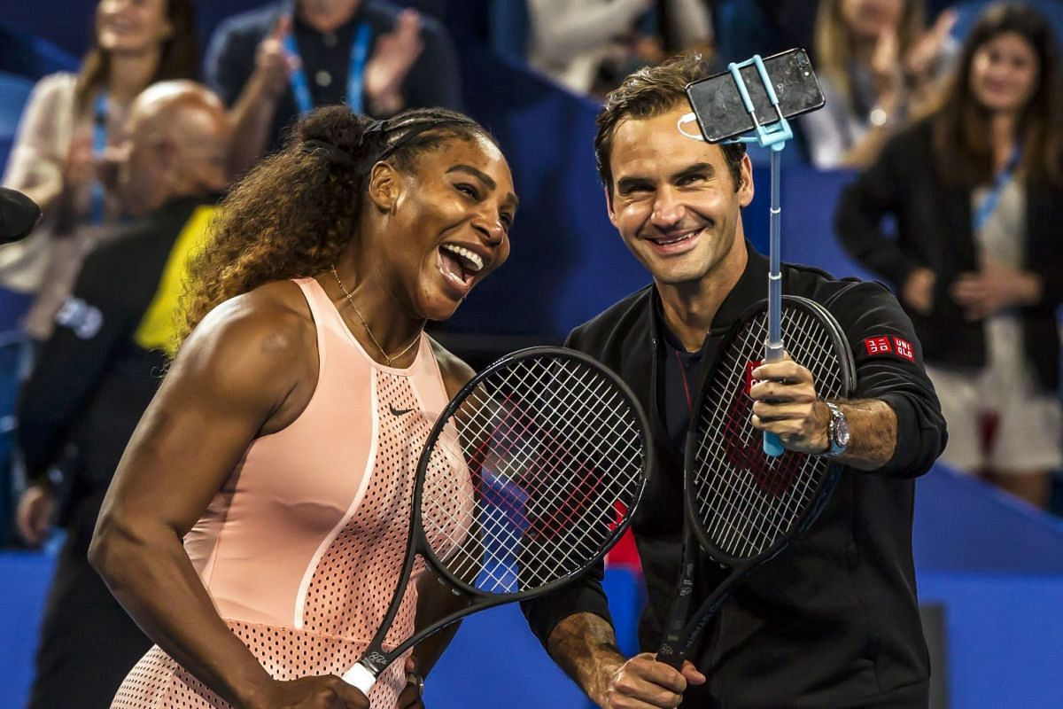 Serena Williams of the US (L) and Roger Federer of Switzerland (R) take a selfie following their mixed doubles match on day four of the Hopman Cup tennis tournament in Perth January 1, 2019. PHOTO: AFP