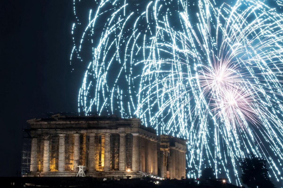 Fireworks explode over the ancient Parthenon temple atop the Acropolis hill during New Year's Day celebrations in Athens, Greece, on Jan 1, 2019.