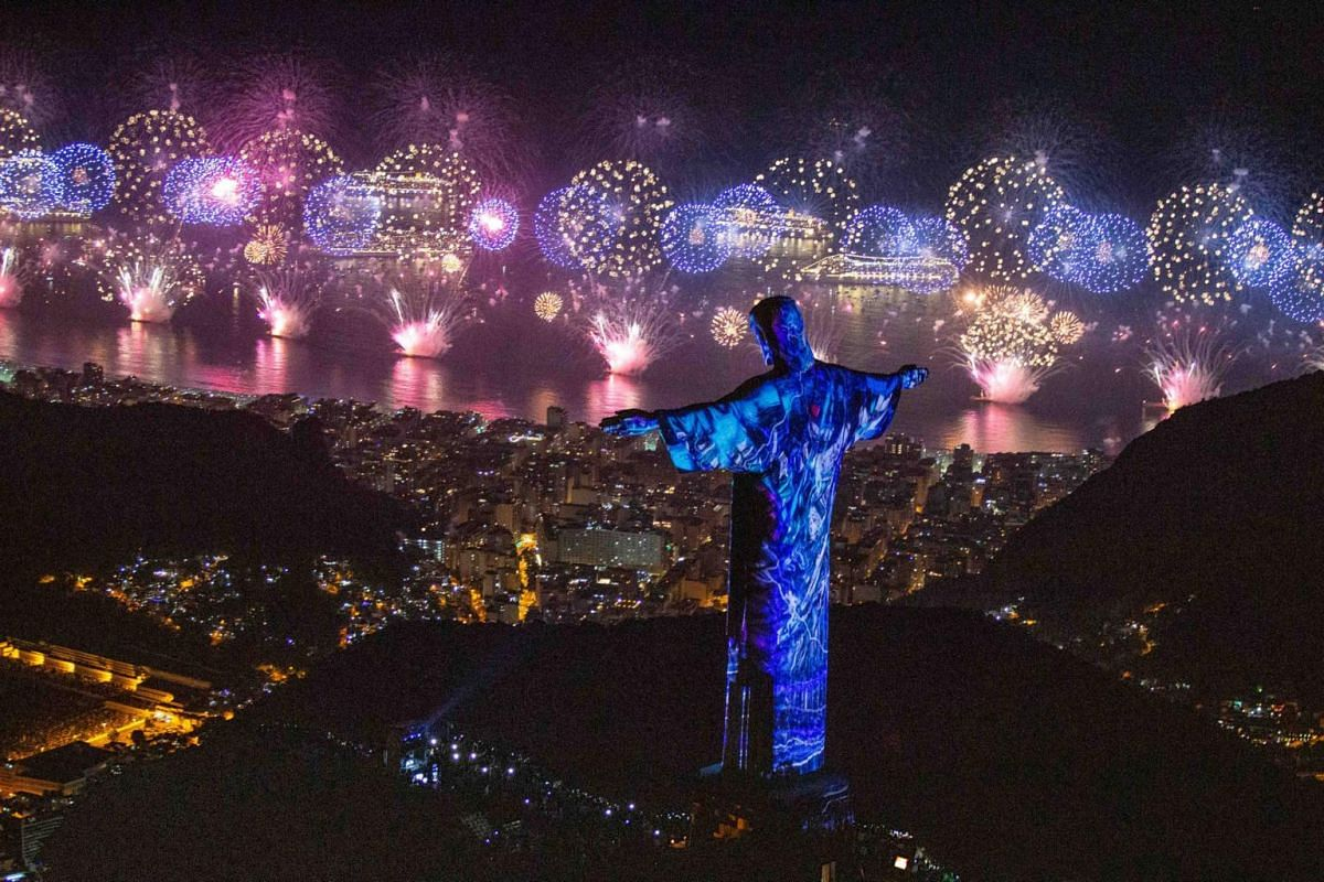 The statue of Christ the Redeemer is seen as fireworks explode over Copacabana beach during New Year celebrations in Rio de Janeiro, Brazil, on Jan 1, 2019.