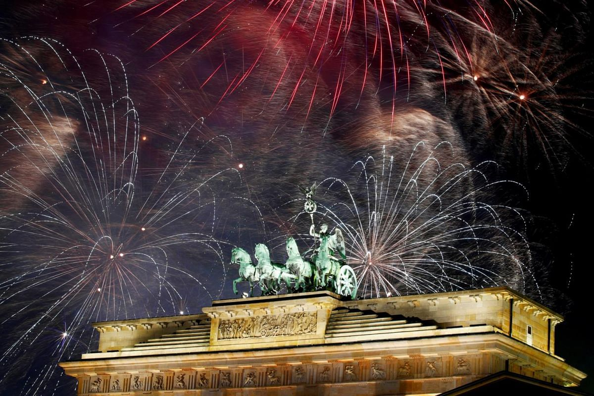 Fireworks explode over the Quadriga sculpture atop the Brandenburg gate during New Year celebrations in Berlin, Germany, on Jan 1, 2019.