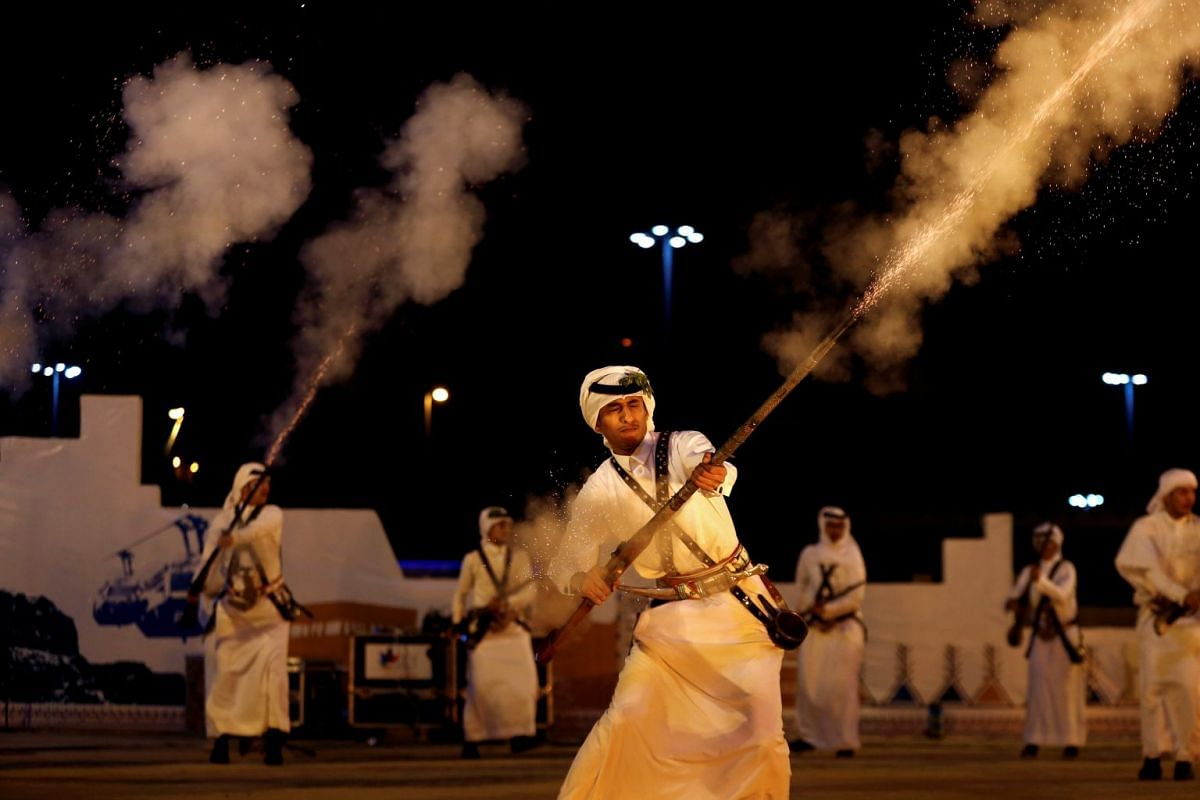 Saudi men fire weapons as they perform a traditional dance during Janadriyah Cultural Festival on the outskirts of Riyadh, Saudi Arabia January 1, 2019. Picture taken January 1, 2019. PHOTO: REUTERS