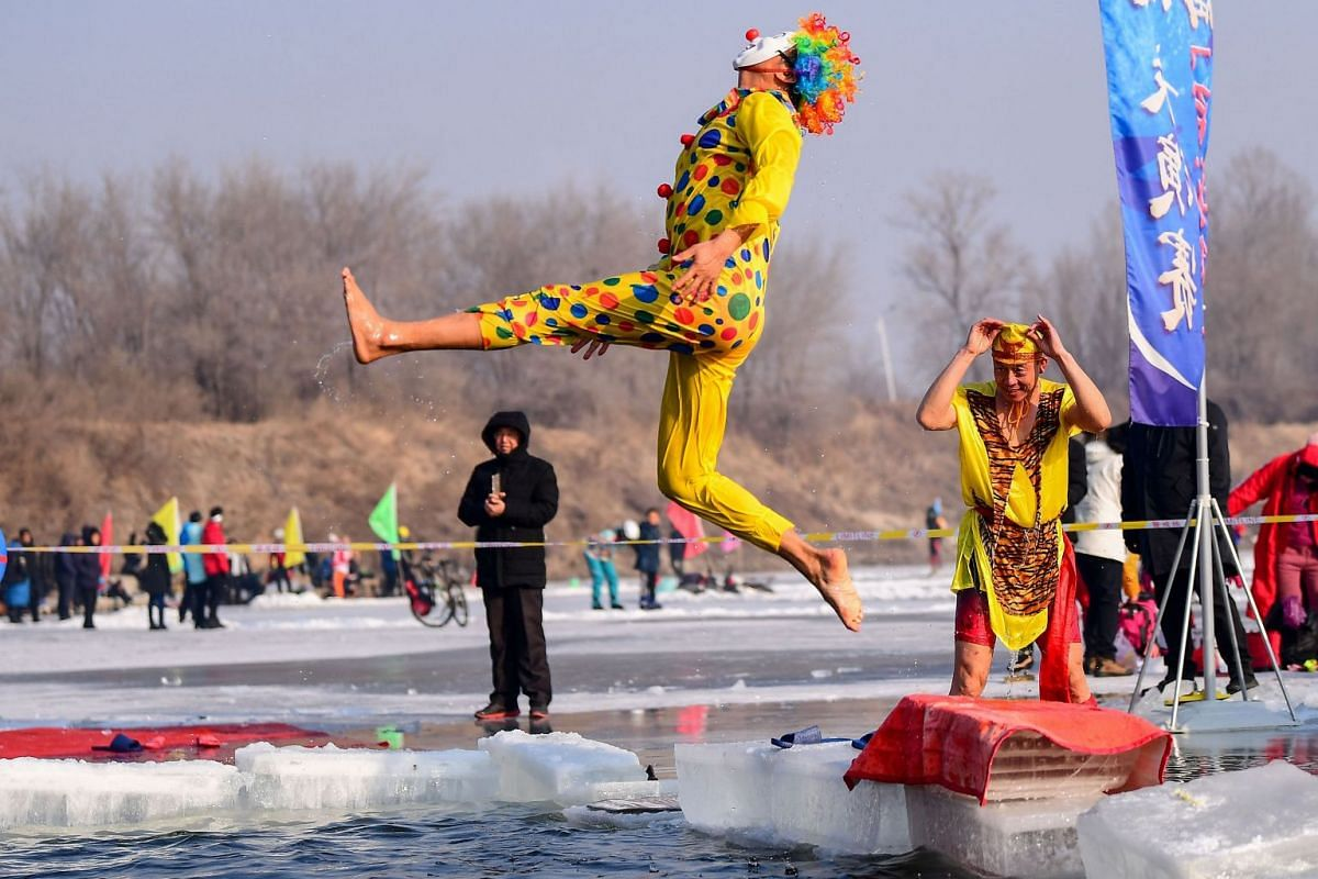 This picture taken on January 1, 2019 shows a man wearing a costume diving into a partly frozen lake in Shenyang in China's northeastern Liaoning province at a temperature of minus 21 degrees Celsius (-6 F). PHOTO: AFP