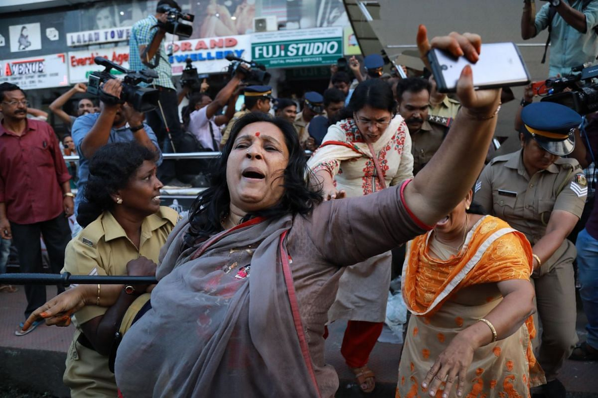 India police intervene as members of Sabarimala Karma Samithi try to disrupt a celebratory meeting after two women entered Sabarimala Ayyapa temple, at the High Court Junction in Kochi in the Indian state of Kerala on January 2, 2019. PHOTO: AFP