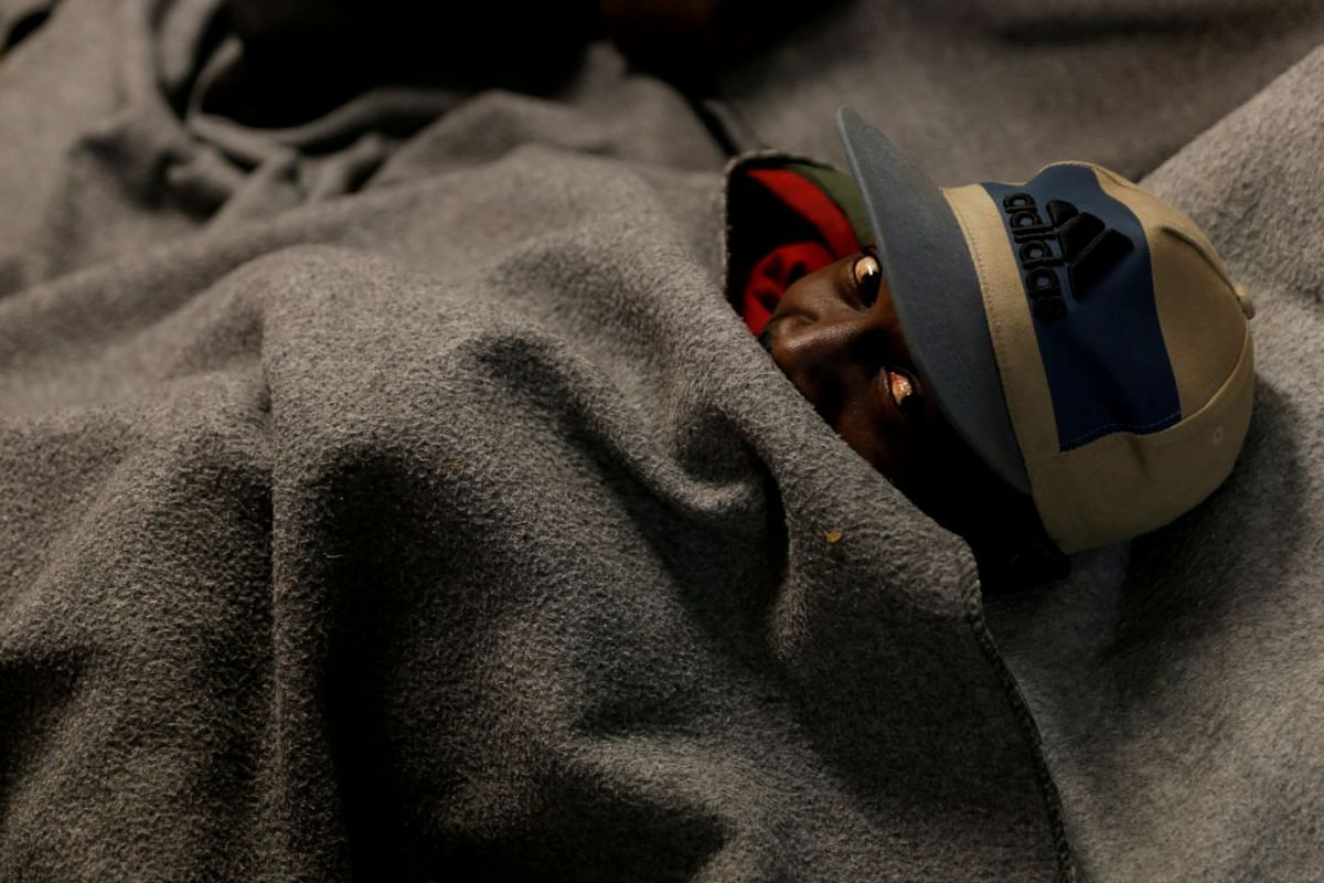 A migrant rests on the migrant search and rescue ship Sea-Watch 3, operated by German NGO Sea-Watch, off the coast of Malta in the central Mediterranean Sea January 3, 2019. PHOTO: REUTERS
