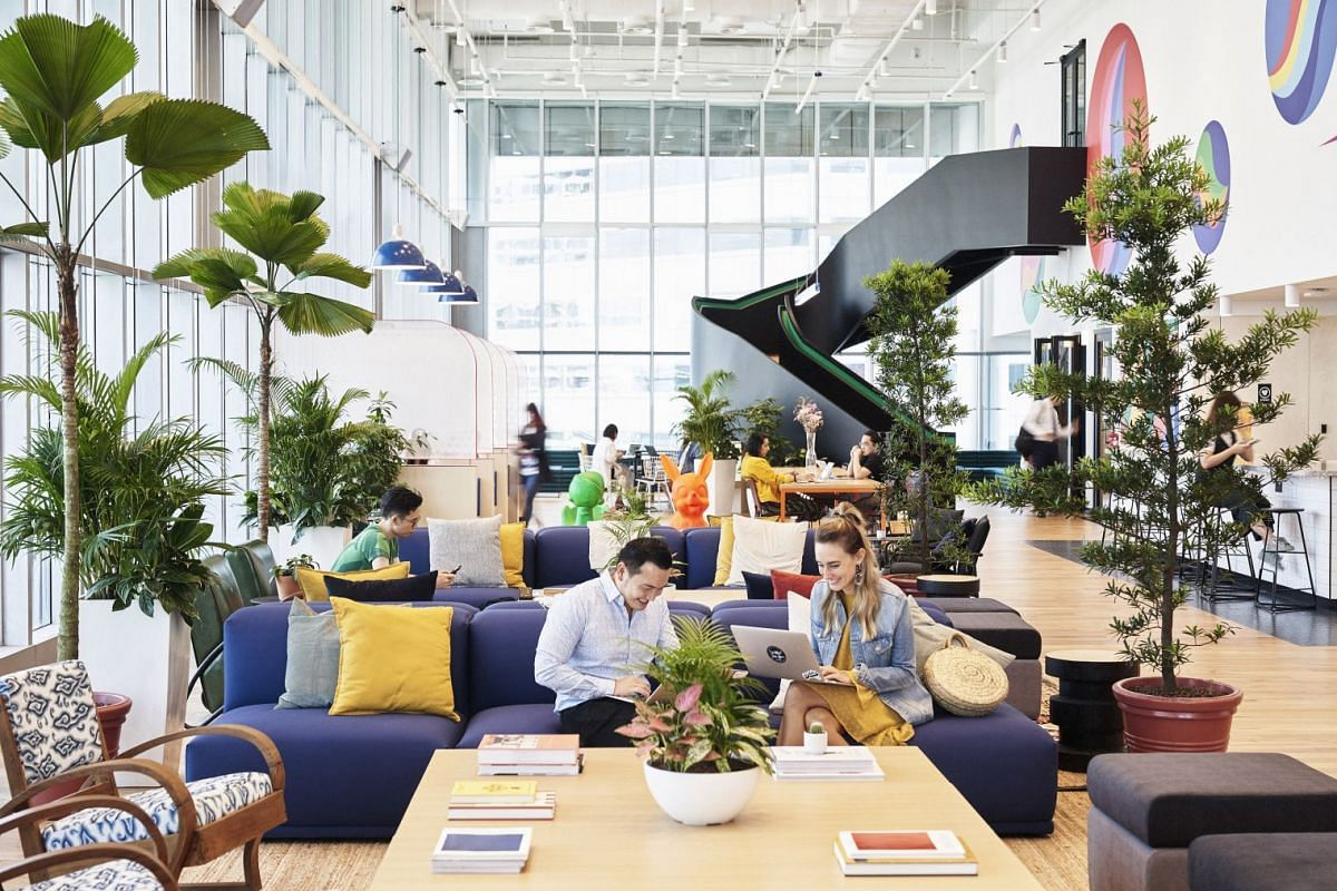 The vibe at New York-based WeWork's outlet (above) at Suntec City Tower 5 is bright and breezy.