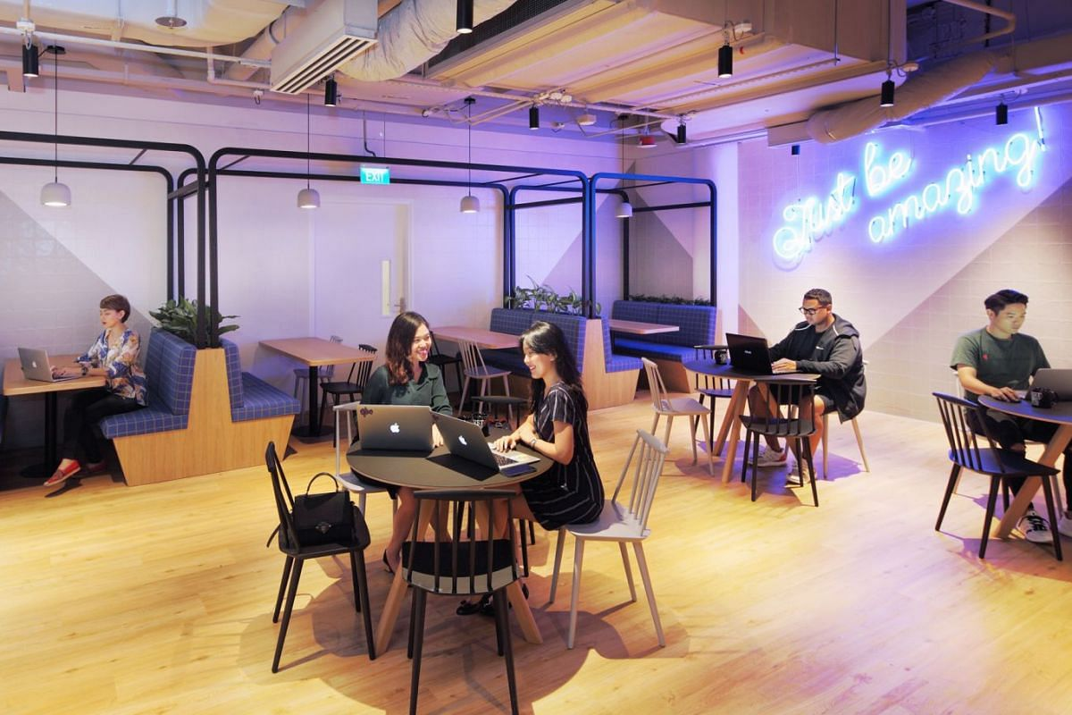 Co-working operator JustCo's Marina Square outlet (above) houses more than 1,000 members, with its biggest tenant being American luxury interior design firm Wilson Associates.