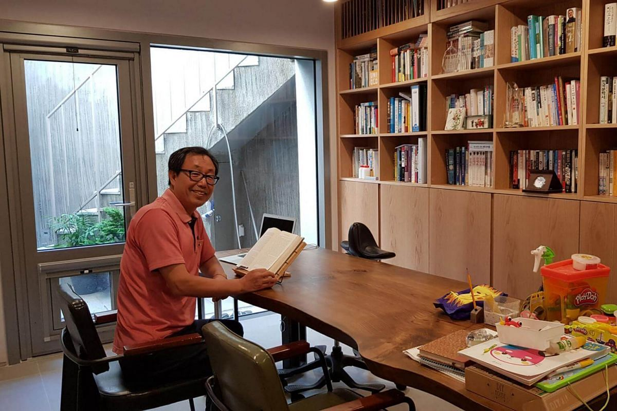 Retiree Kim Sun-dae in his favourite part of his hanok, the basement study where he can read at ease.