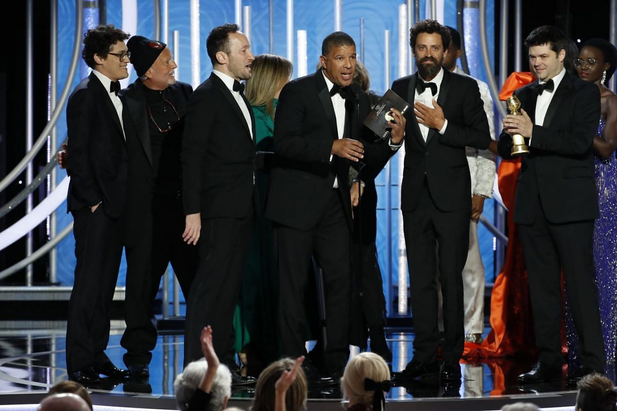 The team behind Spider-Man: Into The Spider-Verse accepting the award for Best Animated Film.