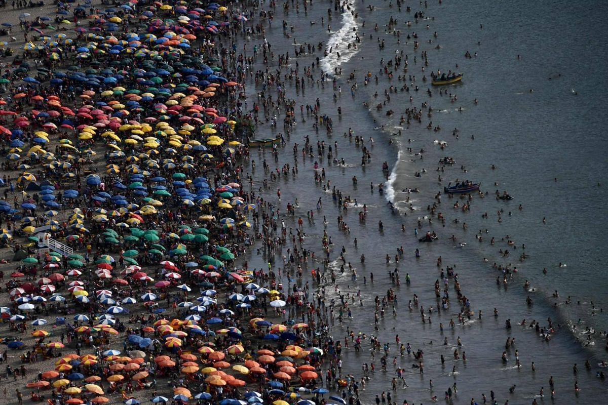Aerial view showing people enjoying the beach in Lima, Peru, on Jan 6, 2019.