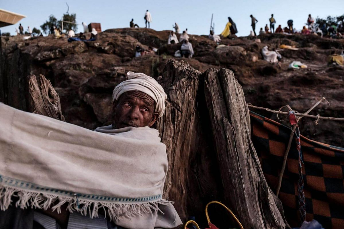 Ethiopian Orthodox pilgrims rest at a pilgrim camp site in Lalibela, Ethiopia, on Jan 5, 2019.