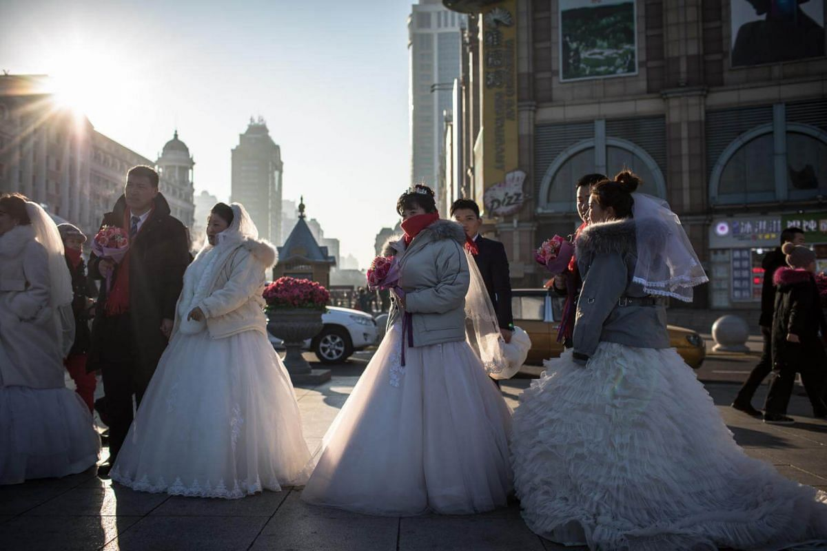 Chinese couples wait for a collective wedding ceremony at the annual Harbin International Ice and Snow Festival, in Harbin, Heilongjiang province, China, on Jan 6, 2019.