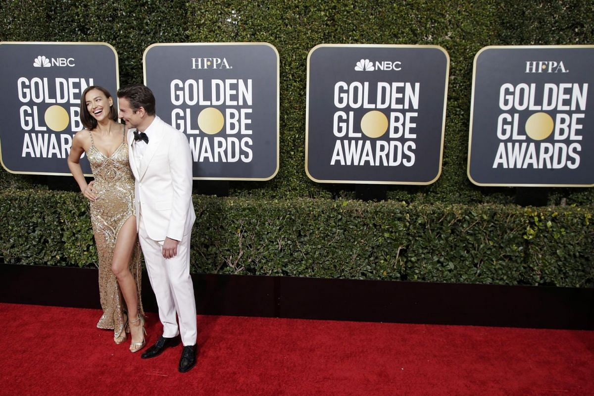Best Actor in a Movie (Drama) and Best Director (Movie) nominee Bradley Cooper and his girlfriend Irina Shayk arrive at the Golden Globe Awards on Jan 6, 2019.