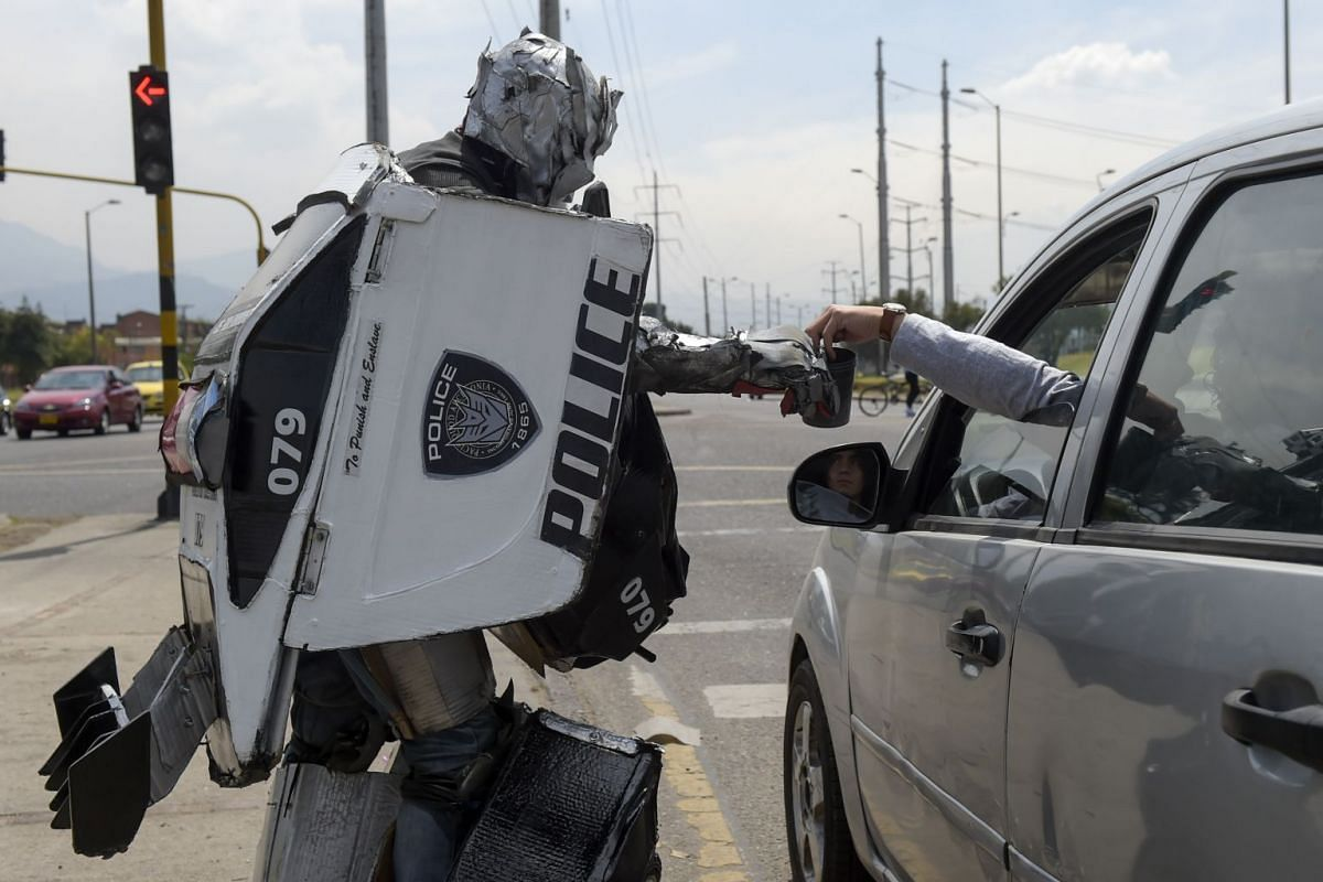 Luis Cruz, an unemployed Colombian, performs as the character Barriacade from the Transformers comic at stoplights in Bogota, Colombia on January 8, 2019. PHOTO: AFP