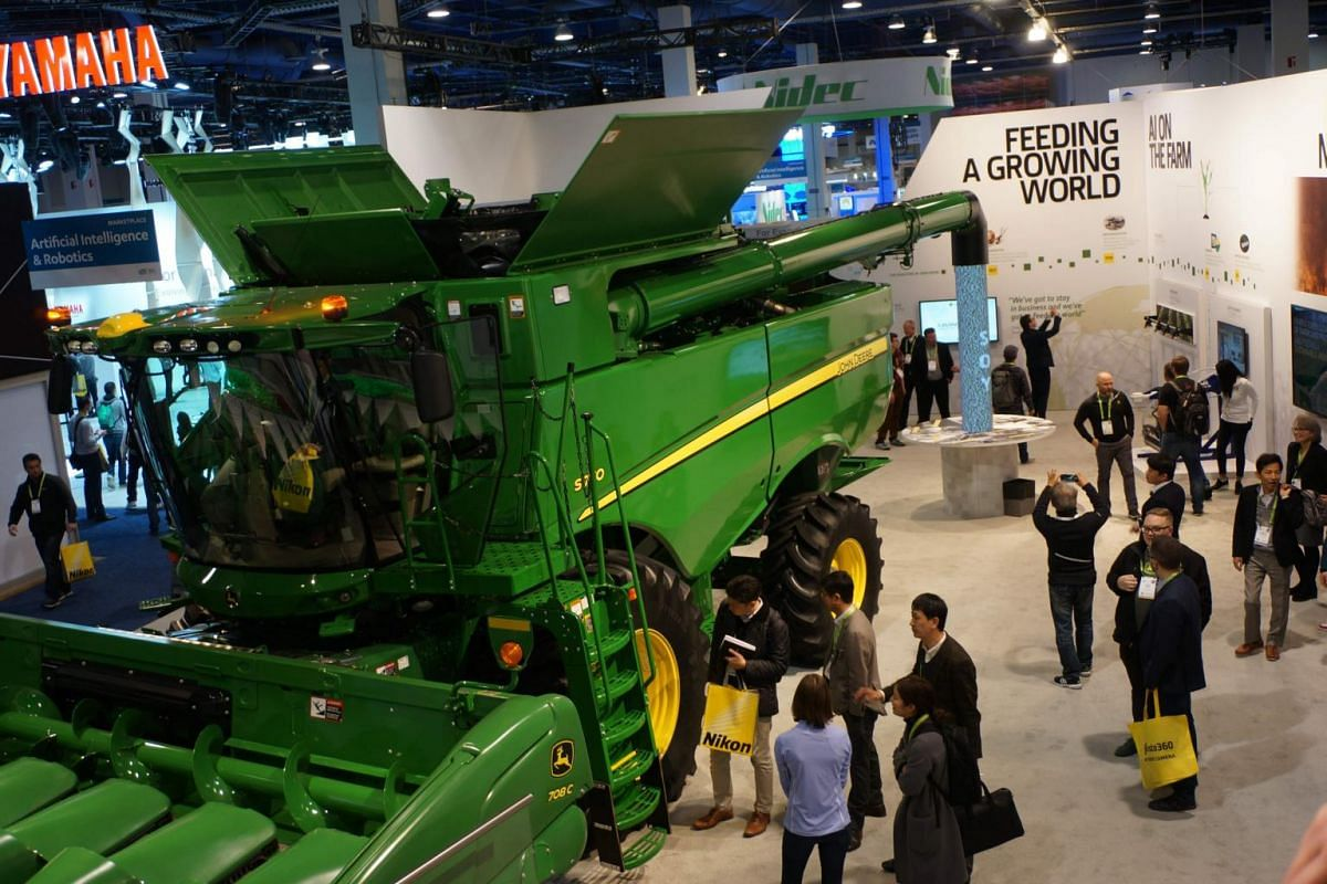 "Farm equipment maker John Deere making its debut at the Consumer Electronics Show with a connected combine harvester, described as an ""intelligent factory on wheels"" and uses GPS, artificial intelligence and sensor technology to help improve yields."