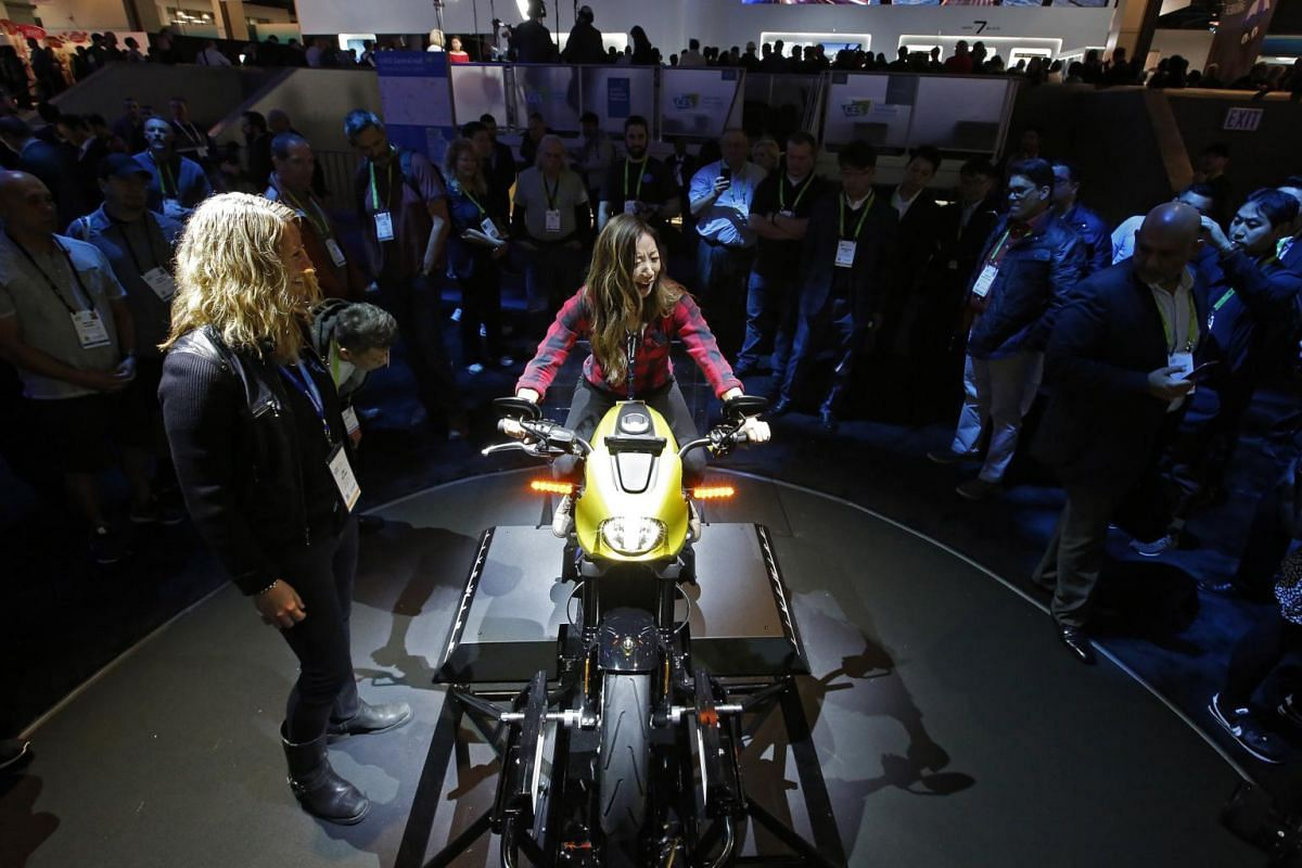 People viewing the new all-electric Harley-Davidson on display at the Panasonic booth.