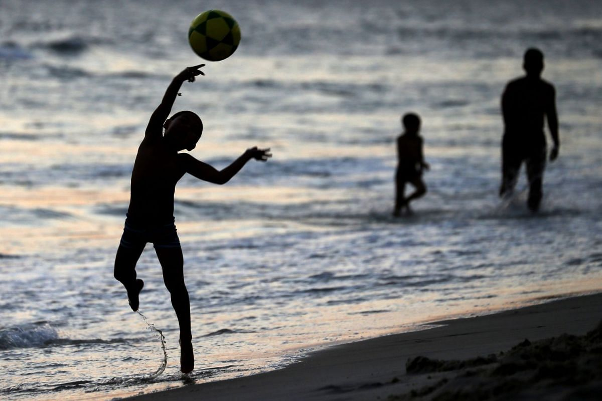 A boy plays on Barra da Tijuca beach in Rio de Janeiro, Brazil January 9, 2019. PHOTO: REUTERS