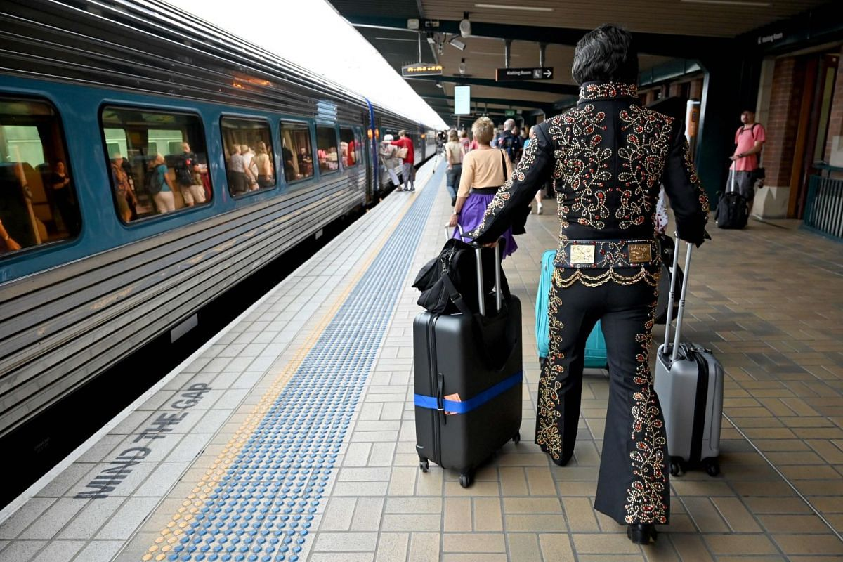 An Elvis impersonator with his luggage at Central station in Sydney on Jan 10, before boarding a train to the Parkes Elvis Festival.