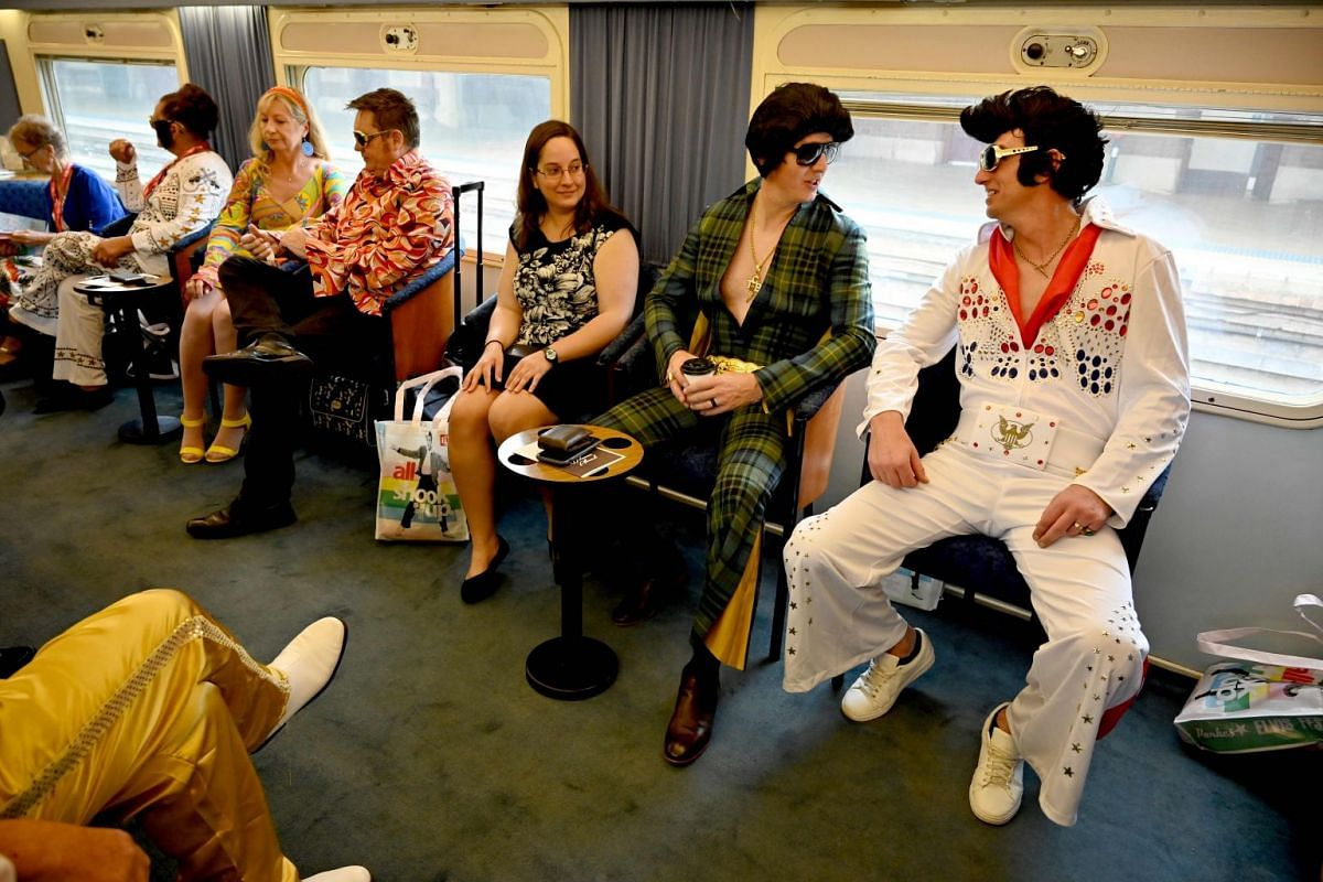 Elvis impersonators on a train after leaving Central station in Sydney on Jan 10, 2019. They are headed to the Parkes Elvis Festival in Parkes, New South Wales.
