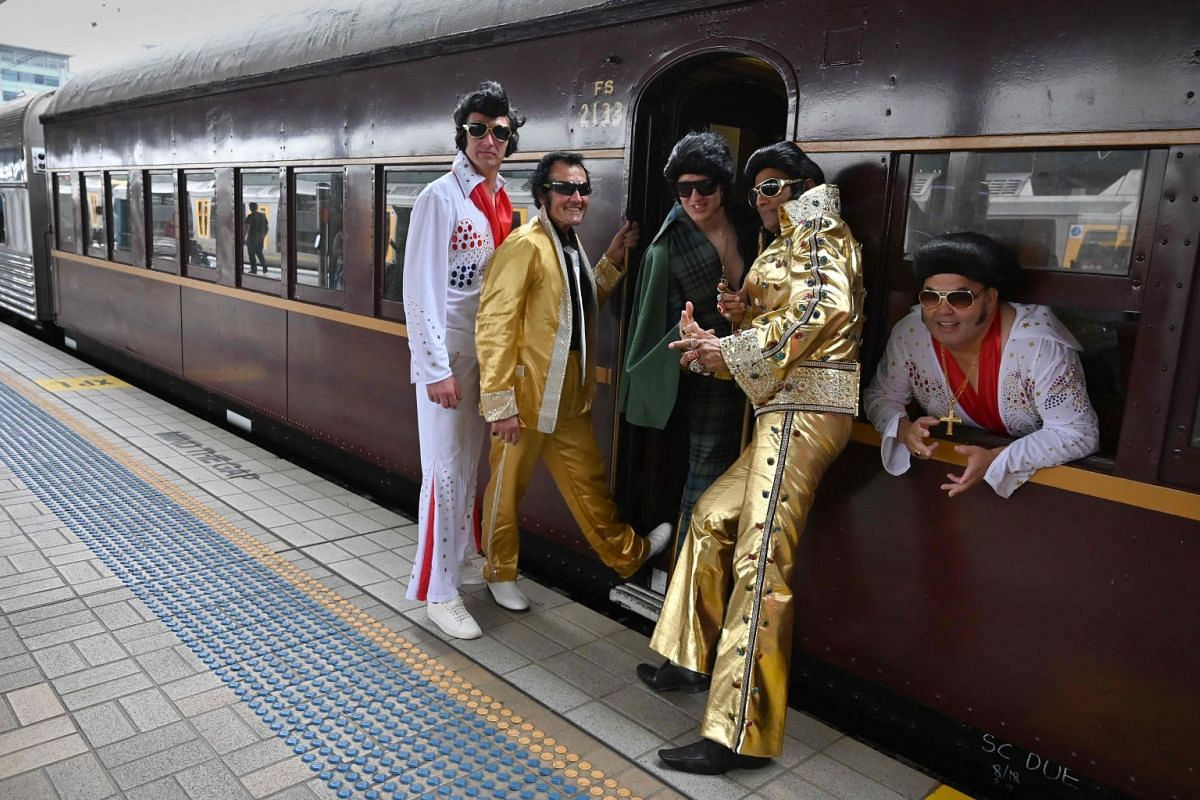 Elvis impersonators and fans at Central station in Sydney before boarding a train to the Parkes Elvis Festival.