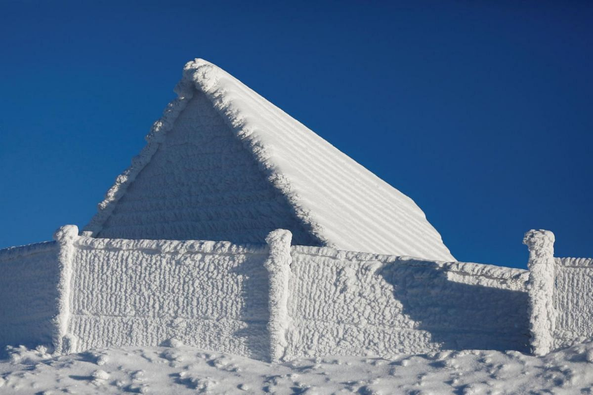 A house is covered with snow at a mountain resort in Szczyrk, Poland.