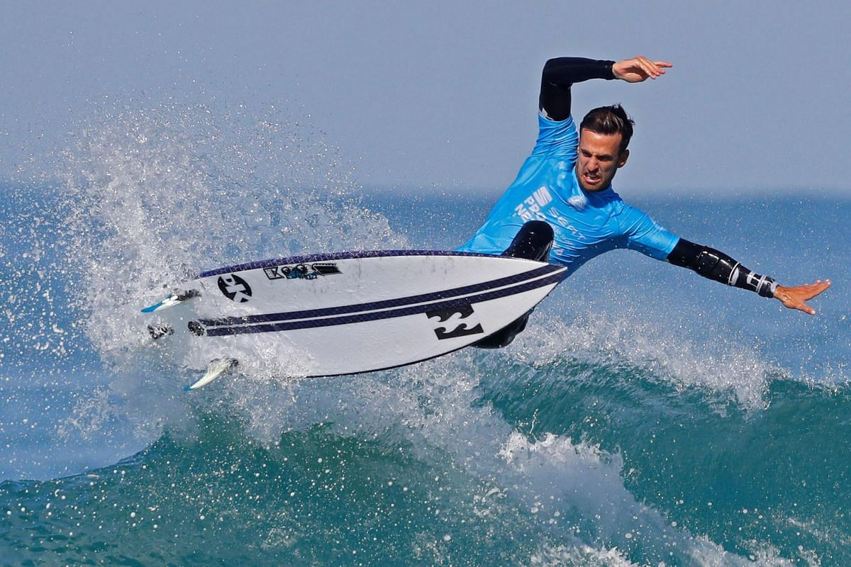 Israel surfer Gil Keren rides a wave during the Men's QS 3,000 of the World Surf League SEAT Pro Netanya qualification, on January 10, 2019, in the Israeli coastal city of Netanya. PHOTO: AFP