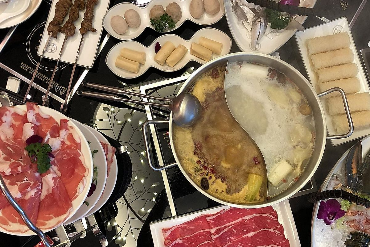 """The Three-Tier Signature Lamb Platter (left) offers three cuts - belly, rack and """"body"""". For the broths (right), The House Original White Soup is best matched with the House Spicy Mala Soup."""