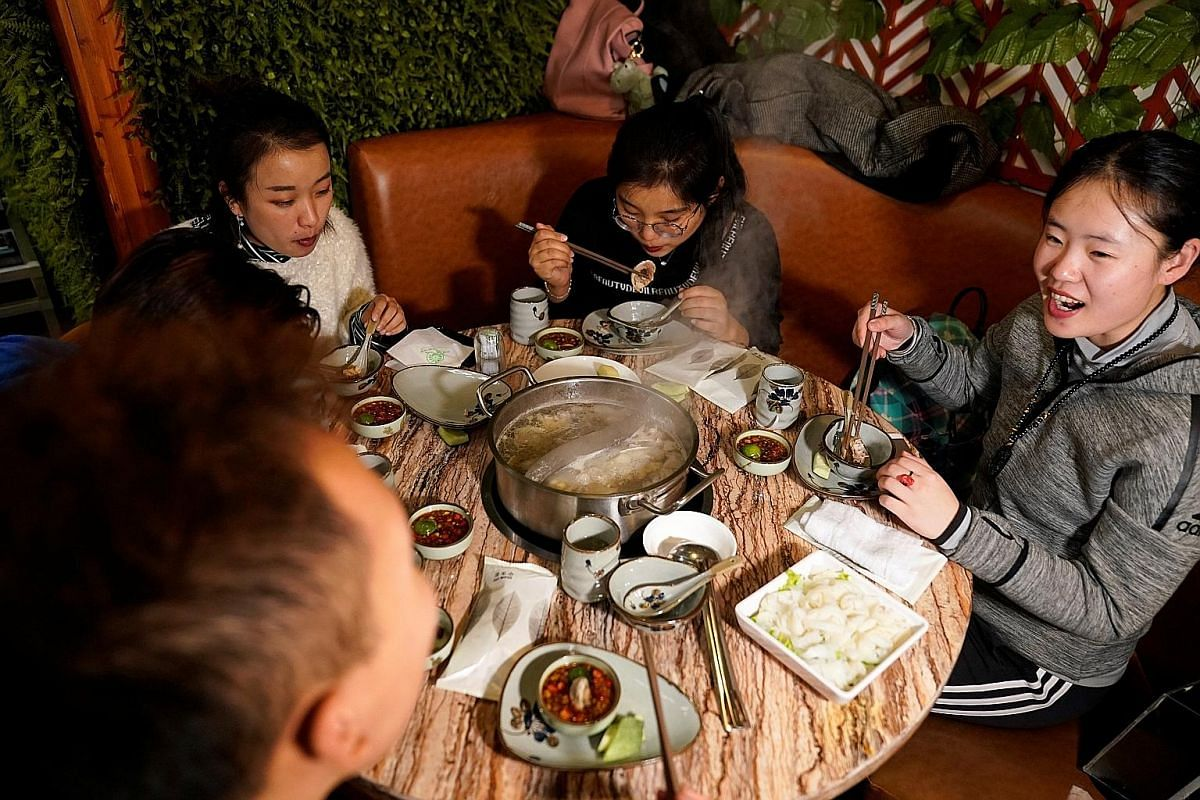 Restaurant operators and the media note that gathering round a hotpot is a popular way to socialise among the Chinese.