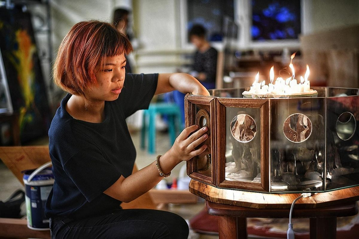 Liza Markus created a sculpture inspired by the tug-of-war she feels regarding her Christian faith and how it was introduced to Indonesia by colonial powers, as well as her curiosity over the Catholic confessional. Nicole Phua's work is inspired by f