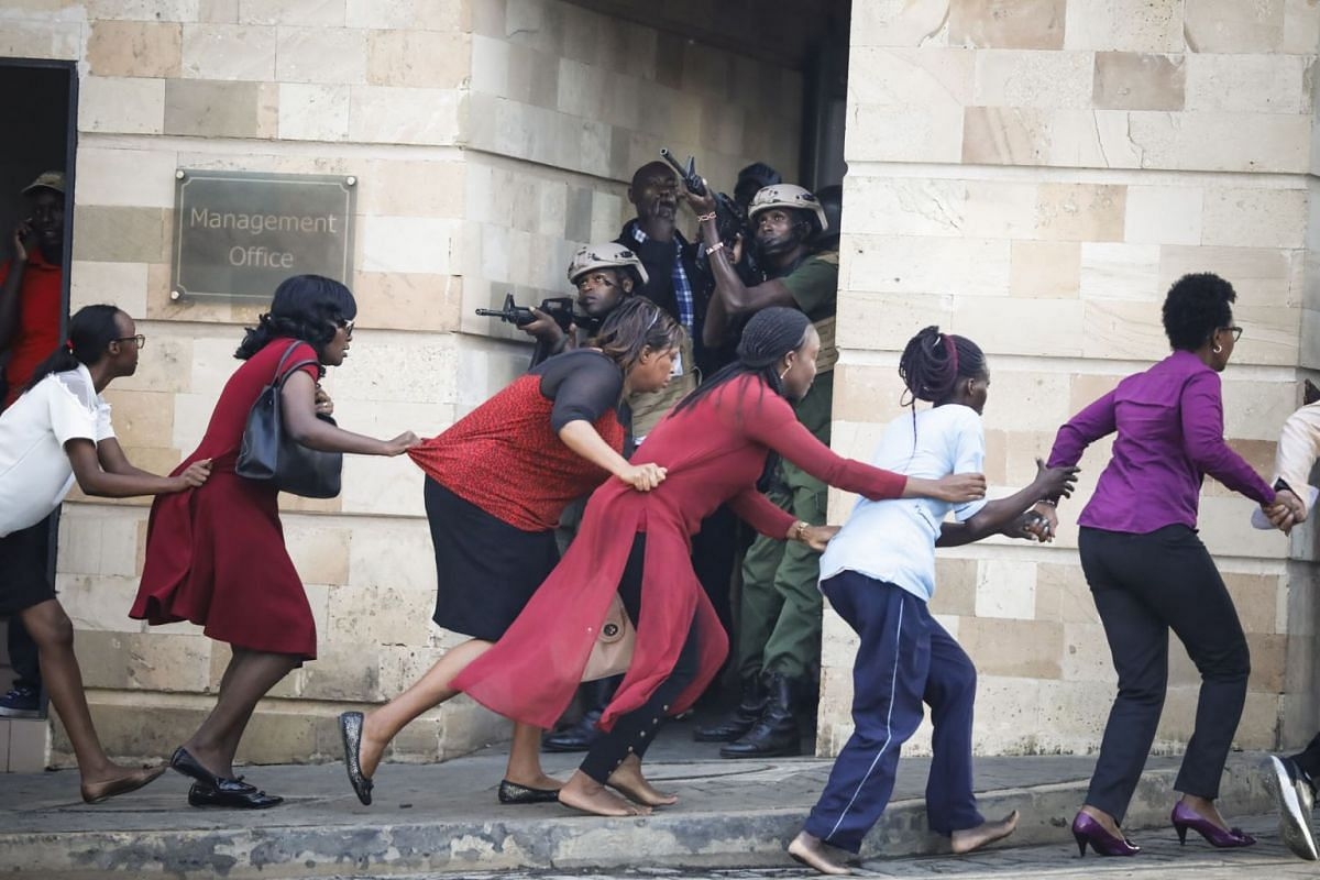 Women are evacuated out of the scene as security officers search for attackers during an ongoing gunfire and explosions in Nairobi, Kenya, on Jan 15, 2019. According to reports, a large explosion and sustained gunfire sent workers fleeing for their l