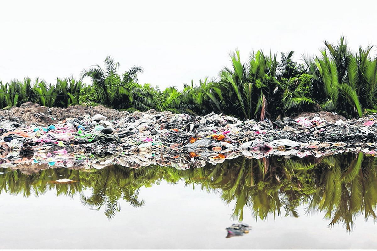 A plastic waste dumpsite near a prawn farm in Jenjarom. Entire batches of prawns have reportedly died.